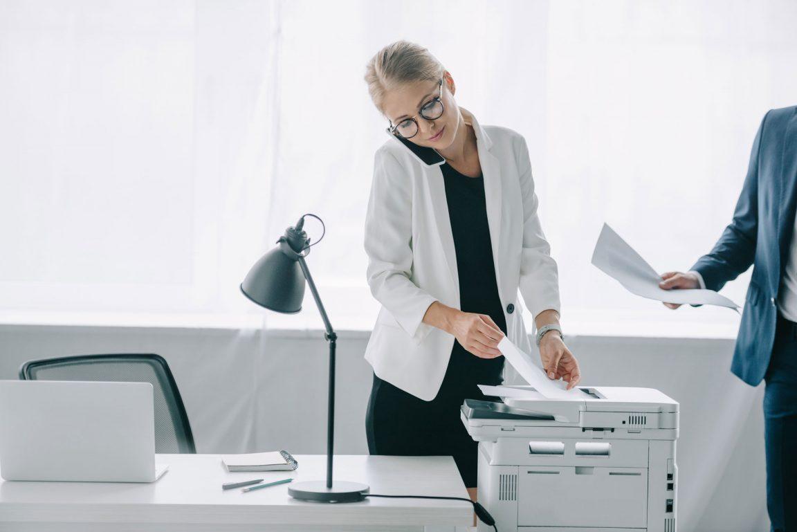 Business woman using digital printer